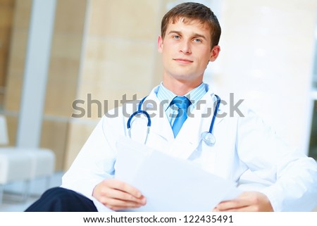 Portrait of friendly male doctor in hospital smiling