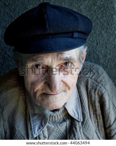 Portrait of friendly senior man - stock photo