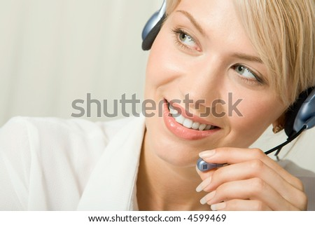 Portrait of friendly smiling telephone operator holding headset