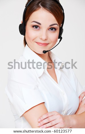 portrait of friendly telephone operator over grey background - stock photo
