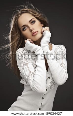 Portrait of friendly woman. Studio photo. - stock photo
