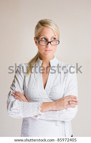 Portrait of friendly young business woman taking a sideways glance. - stock photo