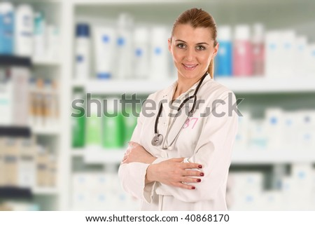Portrait of friendly young doctor over drug store.