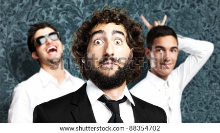 portrait of friends group joking against a vintage wall - stock photo