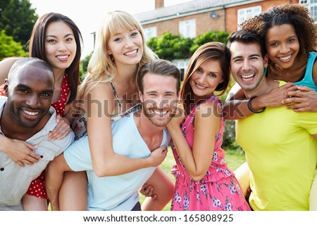 Portrait Of Friends Relaxing In Summer Garden Together - stock photo