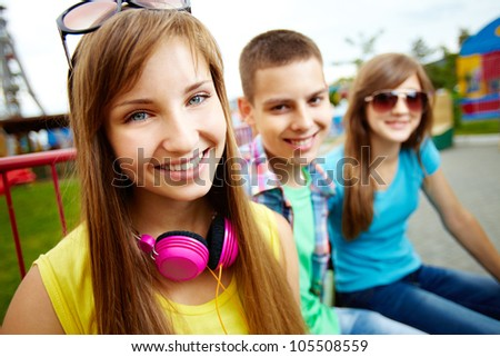 Portrait of friends spending summer vacation together - stock photo