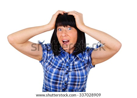 Portrait of frightened and depressed woman 40 years old with big eyes, holds hands on head, mouth open with white teeth, isolated over white background, human emotion, facial expression - stock photo