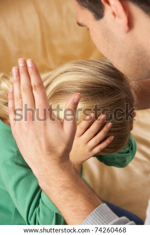 Portrait Of Frightened Daughter Looking At Father - stock photo