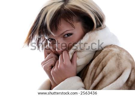 Portrait of frozen girl in fur coat - stock photo