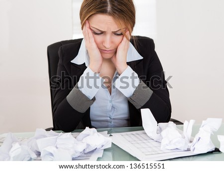 Portrait Of Frustrated Businesswoman In The Office - stock photo