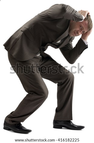 Portrait of frustrated young man holding his head isolated on white backgroud - stock photo