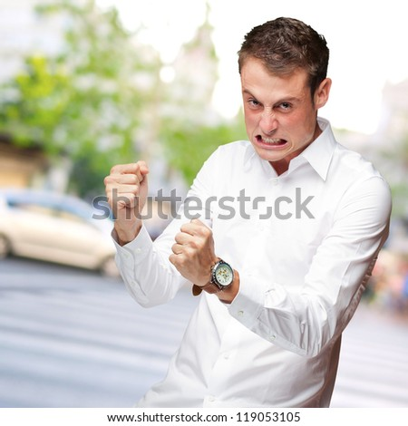 Portrait Of  Frustrated Young Man, Outdoor - stock photo