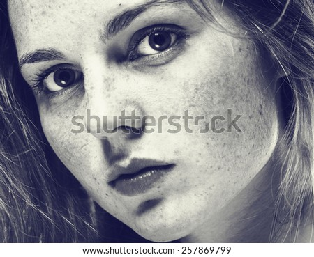 Portrait of fun attractive girl woman with freckles clear skin and beautiful hair black and white