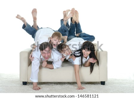 Portrait of fun Caucasian family of four on a light background