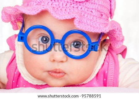 portrait of funny baby with glasses - stock photo