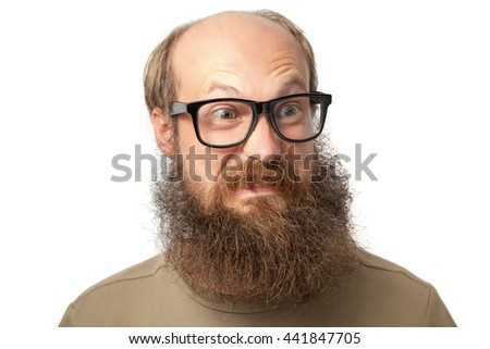 Portrait of funny bald bearded man with glasses isolated on white.