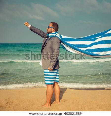 Portrait of funny businessman on the beach. Man having fun by the sea. Summer vacation and travel concept - stock photo