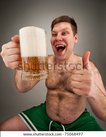 Portrait of funny fat man drinking beer - stock photo