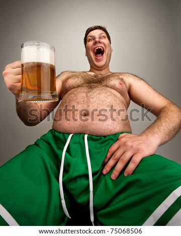 Portrait of funny fat man with glass of beer