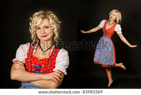 portrait of funny girl in typical oktoberfest dress on black background