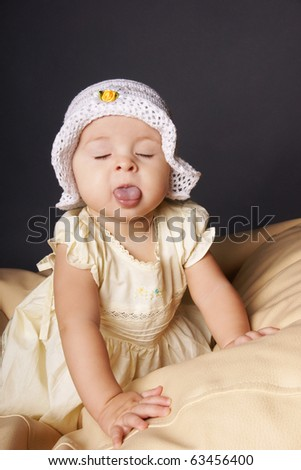 Portrait of funny grimacing baby girl, studio shot - stock photo