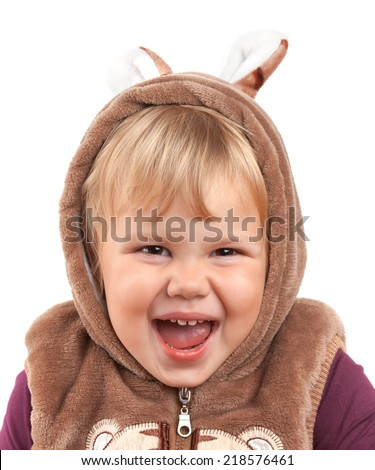 Portrait of funny laughing Caucasian baby girl in bear costume isolated on white