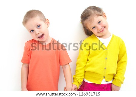 Portrait of funny little boy and a cute girl together - stock photo