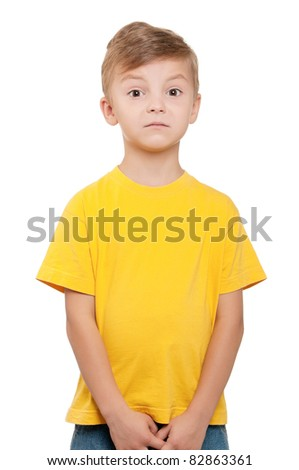 Portrait of funny little boy over white background
