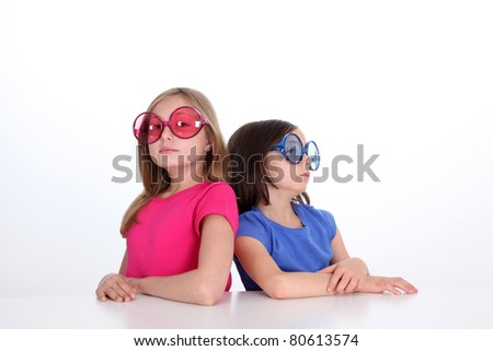 Portrait of funny littlee girls being mad at each other - stock photo