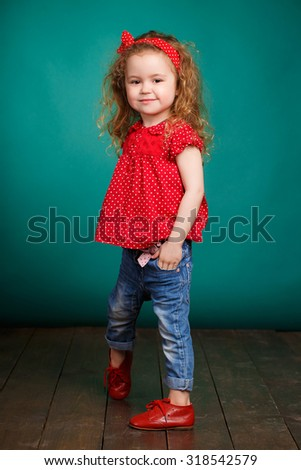 Portrait of funny lovely little girl. Cute little girl on green background. child girl. funny kid studio portrait