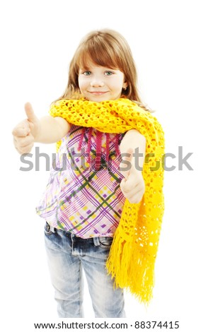 Portrait of funny lovely little girl wearing scarf, showing thumbs up with both hands over white background - stock photo