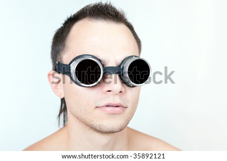 Portrait of funny man in stylish glasses