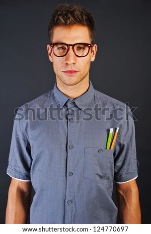 Portrait of funny nerd man with pencls and glasses