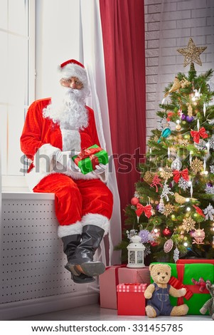 Portrait of funny Santa Claus with gifts