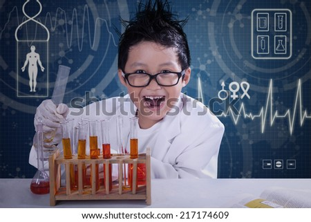 Portrait of funny scientist doing research with chemical fluid and glassware - stock photo