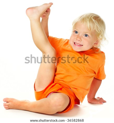 portrait of funny stretching little girl - stock photo