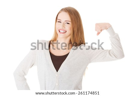 Portrait of funny woman showing her muscles. - stock photo