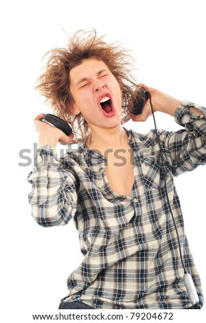 Portrait of funny young man with awesome hairdo isolated on white background. Listening music using headphones