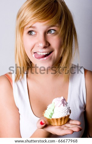 portrait of funny young woman with cake - stock photo