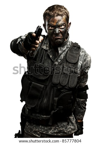 portrait of furious soldier with urban camouflage pointing with gun over white background - stock photo
