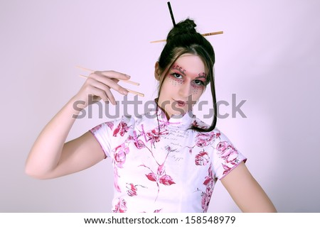 portrait of geisha with  chopsticks - stock photo