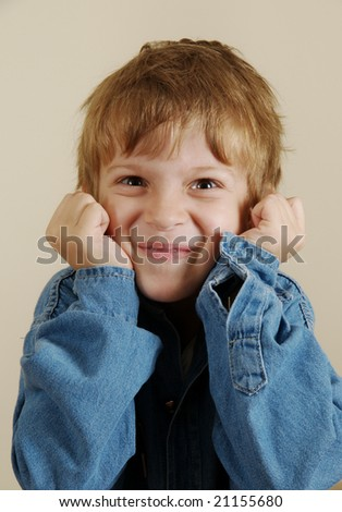 Portrait of  gesturing Caucasian boy in shirt - stock photo