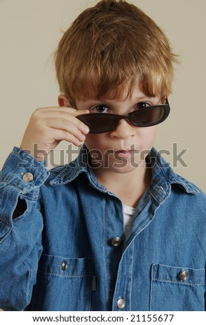 Portrait of  gesturing Caucasian boy with sun glasses - stock photo