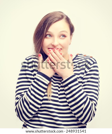 Portrait of  giggling girl staring at the camera - stock photo