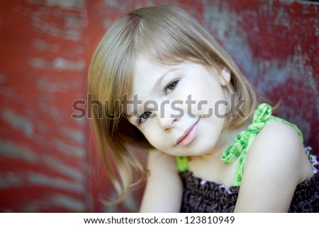 Portrait of Girl Against Barn - stock photo