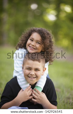 Portrait of girl and boy smiling - stock photo