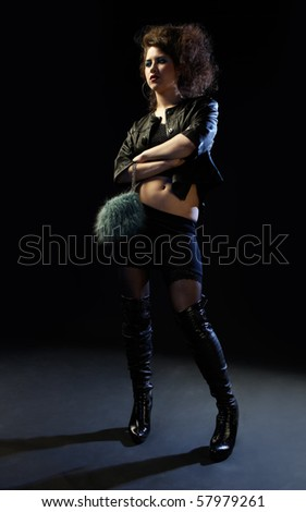 portrait of girl dressed like hooker posing on black - stock photo