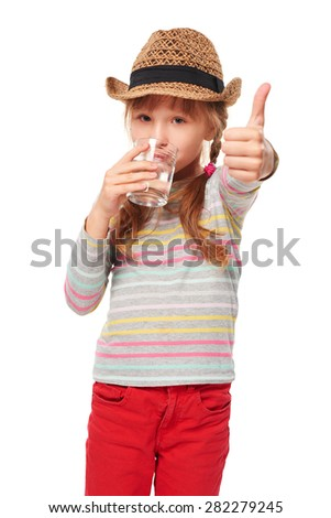 Portrait of girl drinking glass of water and gesturing thumb up, isolated in white - stock photo