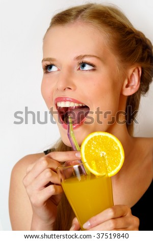 Portrait of girl drinking juice and laughing