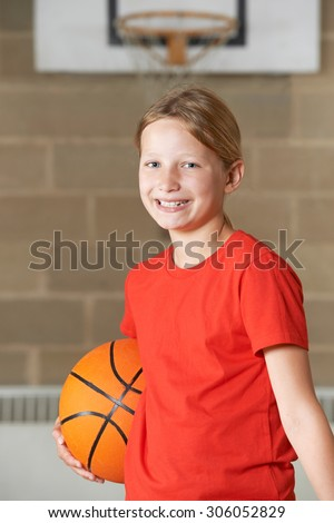 Portrait Of Girl Holding Basketball In School Gym - stock photo